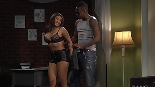 Busty Asian bombshell in a miniskirt Emi Reyes pounded by a black guy