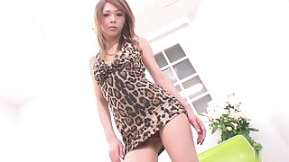 Asian woman in a short dress enjoys showing off her body