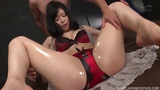 oiled Miyamura Nanako spreads will not hear of legs for a penis greatest extent she moans